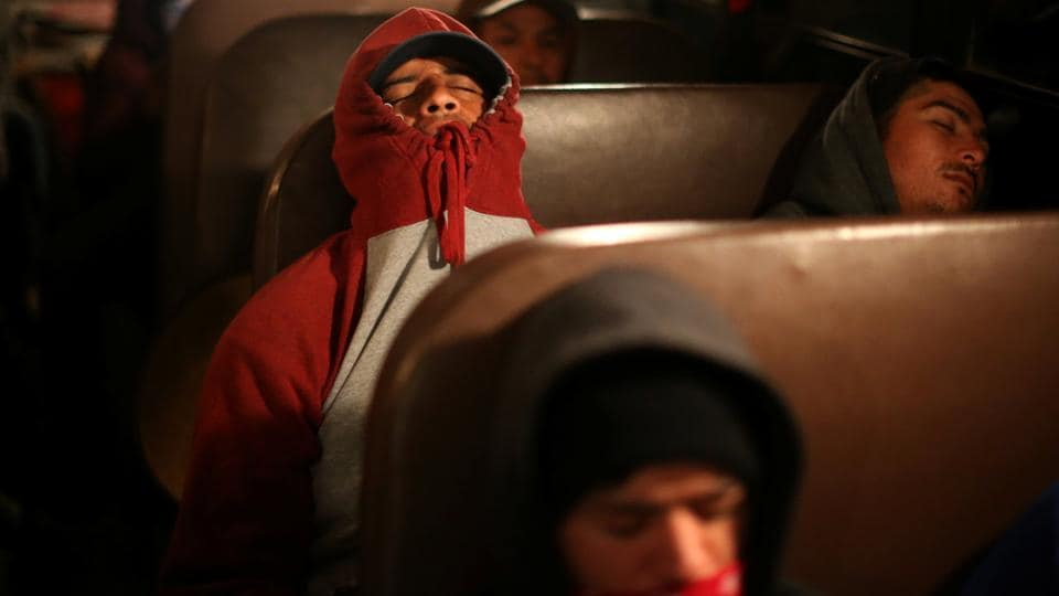 On an overcast spring morning, about 40 Mexican men turned out in the predawn hours to board a bus for California's Salinas Valley where they would harvest  lettuce over the next three days.  (Lucy Nicholson /REUTERS)