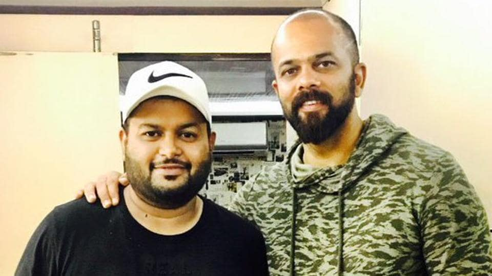 Thaman poses with filmmaker Rohit Shetty.