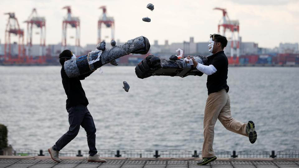 "Members of Superhuman Sports Society demonstrate 'Rock Hand Battle' sport in Tokyo, Japan, April 13, 2017. Japan has a rich history spanning ancient legends and sport to popular comics and video games. Now a new generation of inventors is drawing on this culture to create sports with a 21st-century twist -- helping players feel 'superhuman"" through technology or other special equipment."