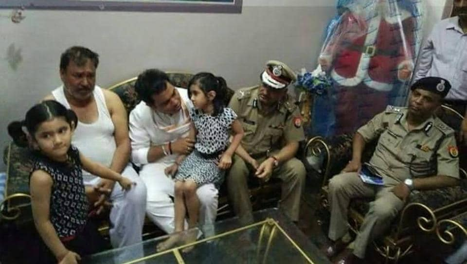 DGP Sulkhan Singh and state energy minister Srikant Sharma with the relatives of slain jeweller Vikas Agarwal at their residence in Mathura on Wednesday.