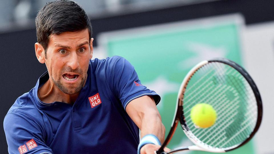 Novak Djokovic returns a ball to Britain's Aljaz Bedene during their second round match at the Rome Masters.