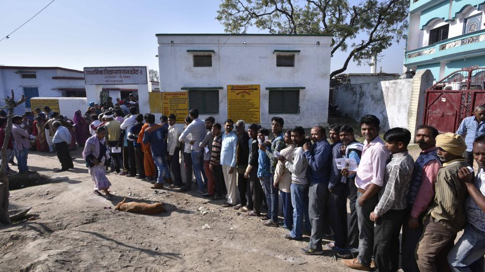 Voters line up to cast their votes at a polling station at Ayodhya for assembly polls in Uttar Pradesh on February 27.