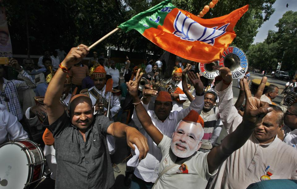 Bharatiya Janata Party workers celebrate after the party's victory in the 2014 Lok Sabha elections.