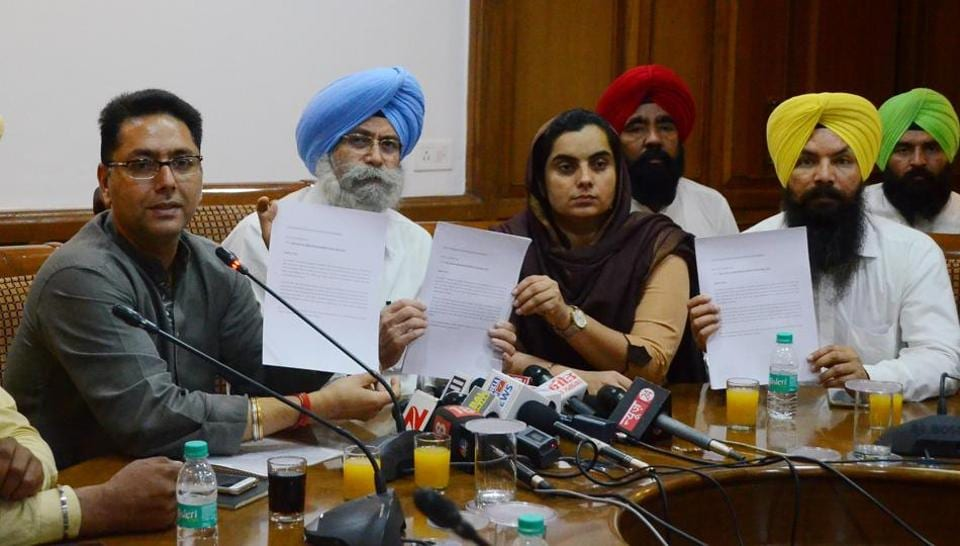 Aam Aadmi Party leaders Aman Arora (left) and HS Phoolka during a press conference in Chandigarh on Tuesday.