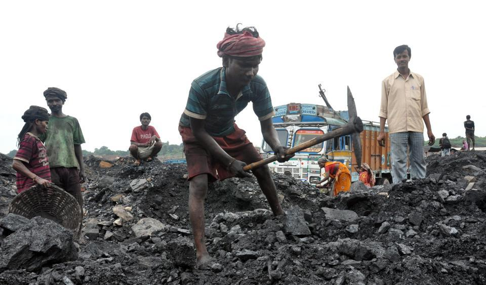 Coal miners loading truck in Dhanbad.
