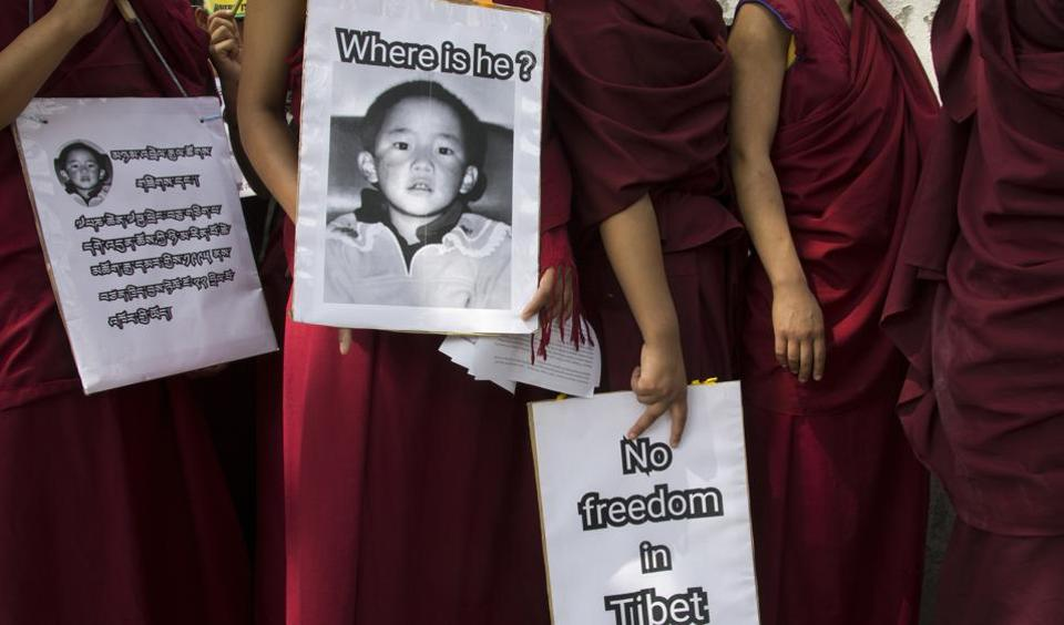 Buddhist nuns carry placards during a protest march demanding the release of religious leader Gedhun Choekyi Nyima, the 11th Panchen Lama, who was put under house arrest by the Chinese authorities on this day in 1995. Panchen Lama is the second most important religious leader in Tibetan Buddhism, after the Dalai Lama. The Dalai Lama was involved in recognizing the Panchen Lama, and in turn the Panchen Lama is also historically part of the process by which each new Dalai Lama is chosen. (Ashwini Bhatia/AP)