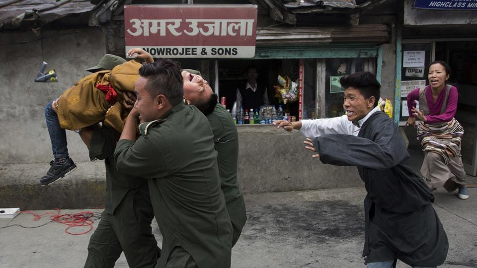 Exiled Tibetans enact a street play of abducting their religious leader Gedhun Choekyi Nyima, the 11th Panchen Lama by Chinese policemen. The abduction of Panchem Lama is considered by Tibetan Buddhists as part of China's efforts to destabilise Tibet by introducing political propaganda, controlling its religion and limiting the Dalai Lama's influence. (Ashwini Bhatia/AP)