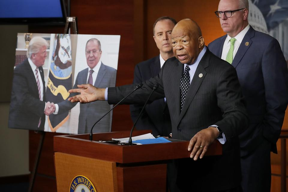 Democrat Elijah Cummings speaks about the controversy surrounding US President Donald Trump's alleged leaks to the Russians while flanked by other lawmakers  at the US Capitol in Washington on Wednesday.