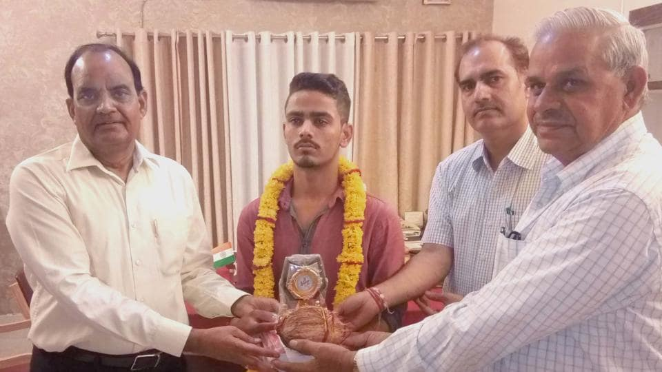 Amit Kumar (second from left), one of the top scorers in the science stream with 98.2% marks in the Class 12 exams of the Rajasthan Board, in Bharatpur on Wednesday.