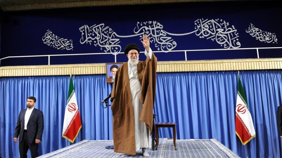 Iran's Supreme Leader Ayatollah Ali Khamenei waves before speaking to the audience in Tehran, Iran, May 17, 2017.