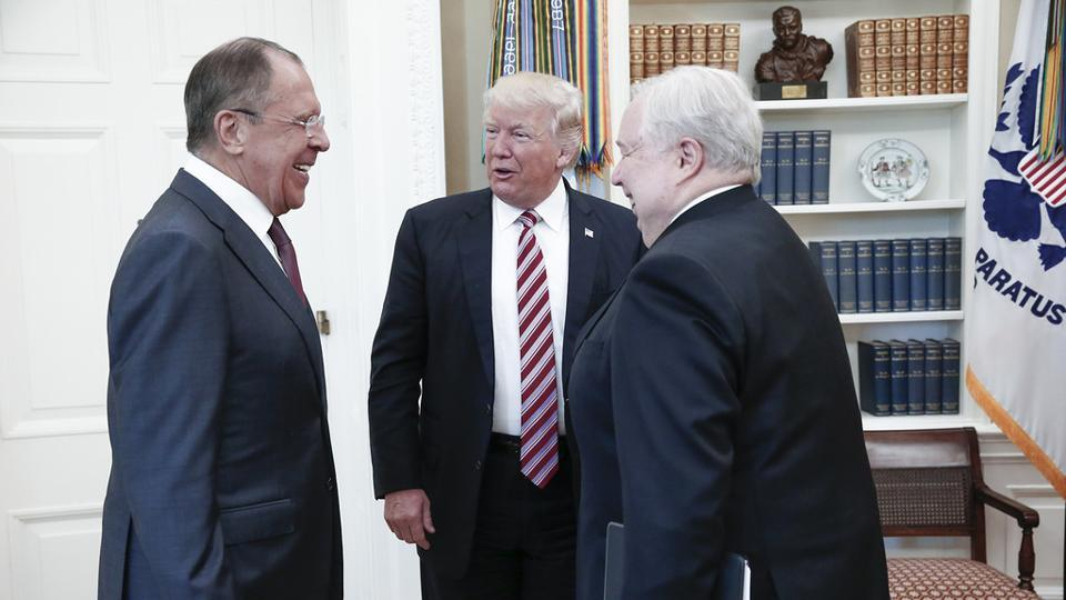 Handout photo taken on May 10, 2017 shows US President Donald Trump (C) speaking with Russian foreign minister Sergei Lavrov (L) and Russian ambassador to the US, Sergei Kislyak during a meeting at the White House in Washington, DC.