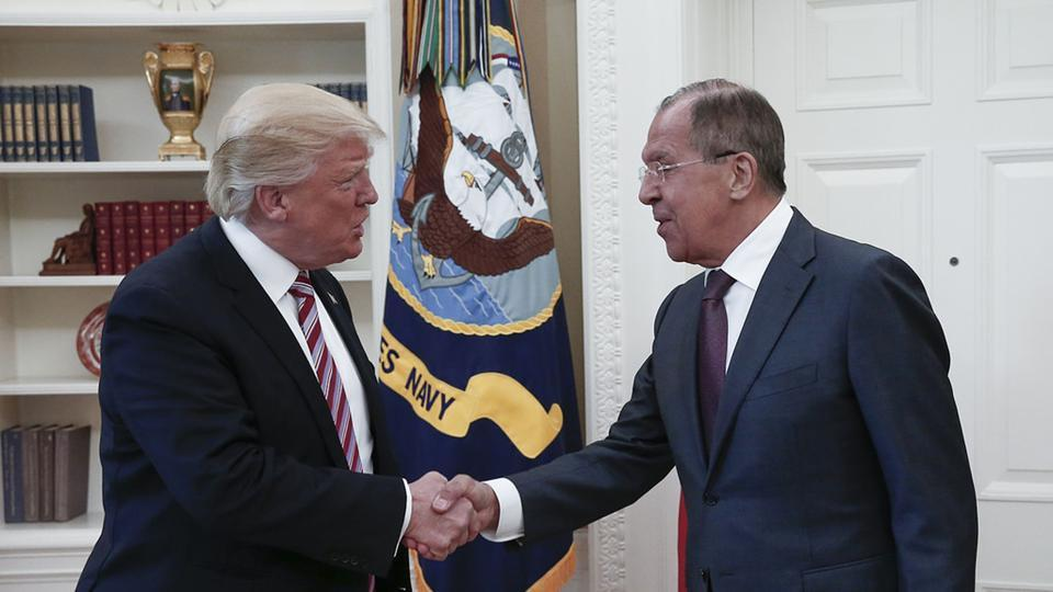US President Donald J. Trump (L) with Russian Foreign Minister Sergei Lavrov ) during their meeting at the White House in Washington, DC, May 10.  Trump takes a benign view of Russia's annexation of part of the Ukraine and, like a true businessman, deeply disapproves of the use of sanctions.