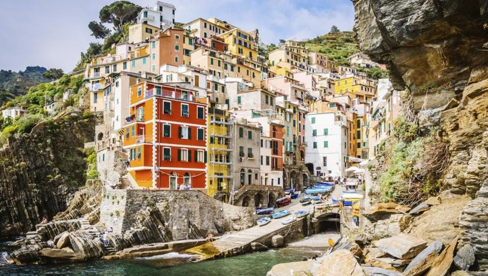 Cinque Terre, Italy, is a string of centuries-old seaside villages on the rugged Italian Riviera coastline.