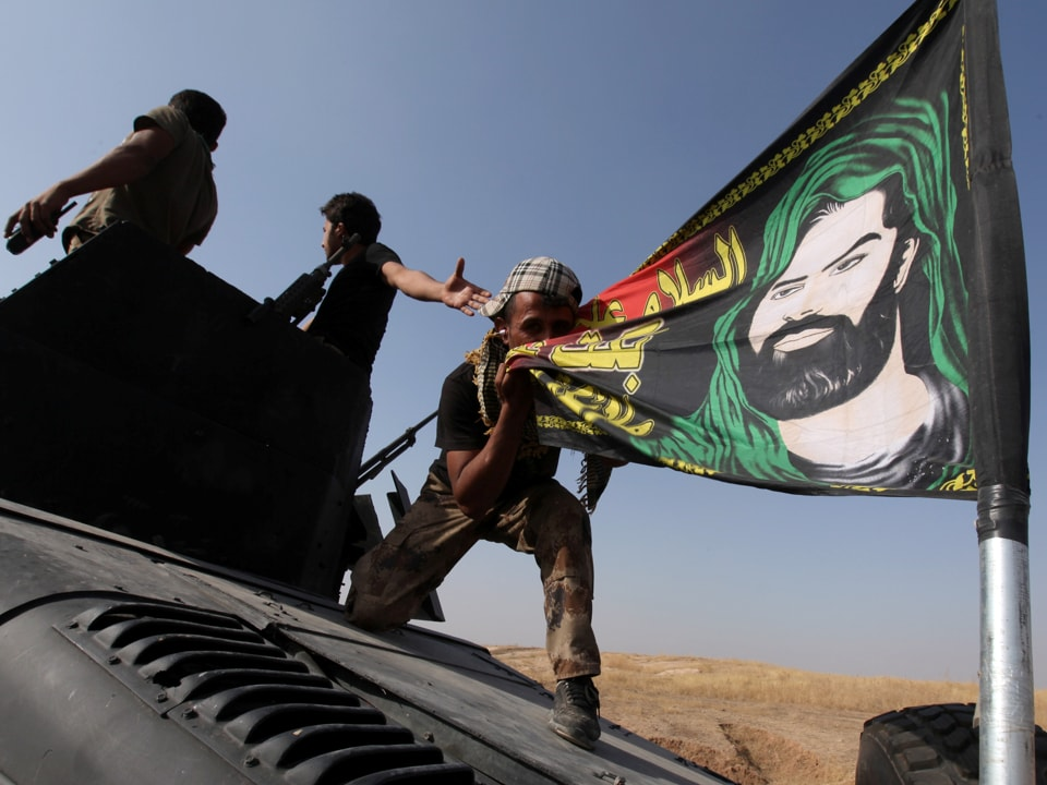 Tens of thousands of Iraqi Shia militiamen are fighting in Syria on behalf of Assad's government, which is backed by Iran, although the PMF is not officially involved across the border.