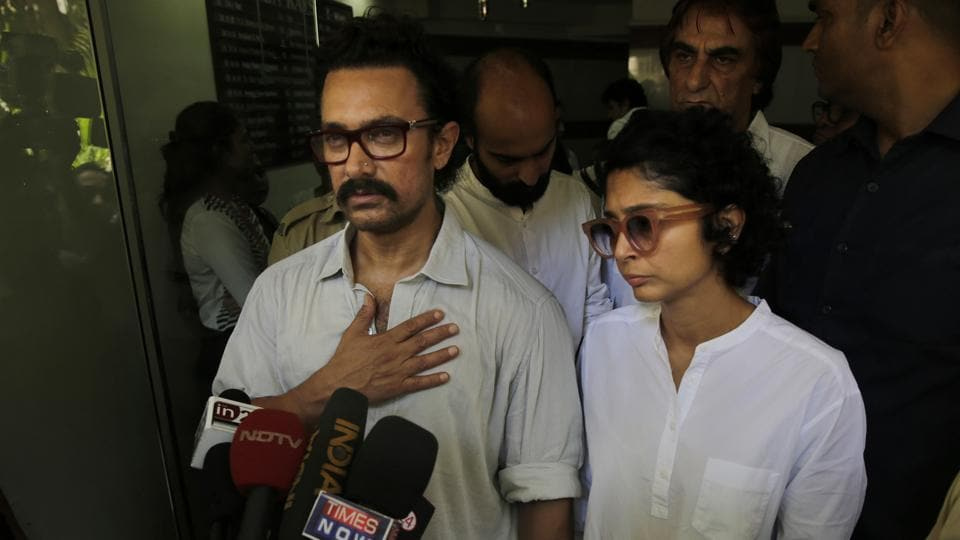 Aamir Khan along with his wife Kiran Rao speaks with media after paying respect to late Reema Lagoo during her funeral in Mumbai.