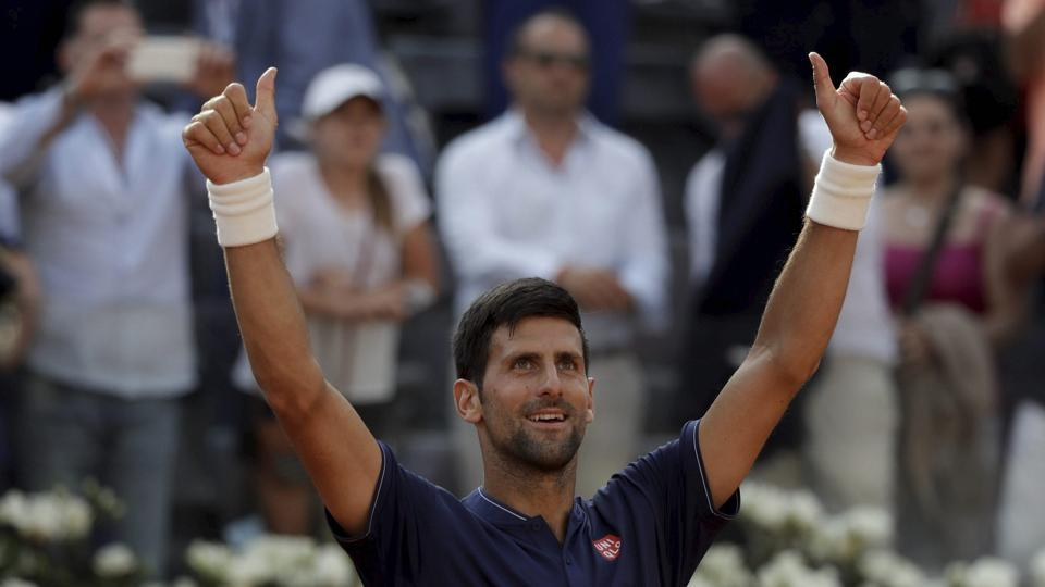 Novak Djokovic celebrates after beating Spain's Roberto Bautista Agut at the Italian Open tennis tournament in Rome on Thursday. Djokovic will take on the winner of the match between Juan Martin del Potro and Kei Nishikori