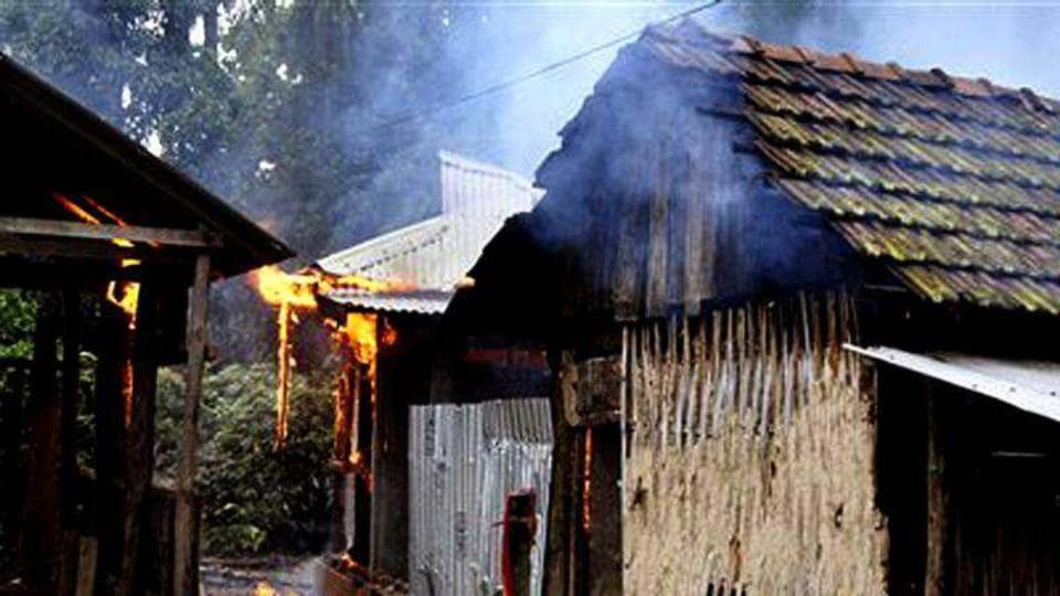 File photo of a burning house in a village in Kokrajhar district where Bodo militants have often unleashed violence.