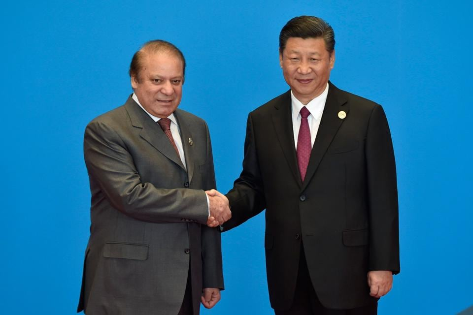Nawaz Sharif (L) with China President Xi Jinping during the Belt and Road Forum in Yanqi Lake, north of Beijing, on Monday.