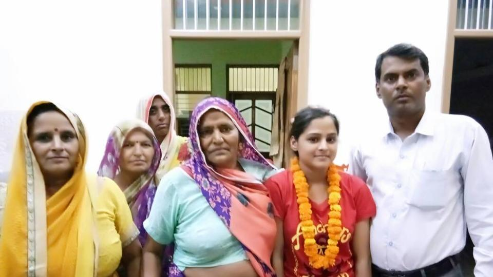 Komal Raghav's family welcomed her with flower garlands at her home in Farrukhnagar on the outskirts of Gurgaon.