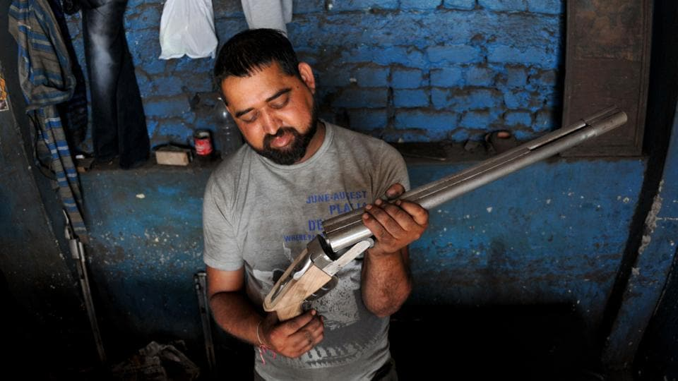 A worker assembles guns at a factory in Jammu. The Indian government banned civilian firearms licenses in the early 1990s in Kashmir valley when an armed rebellion broke out against Indian rule. Subsequently, the majority of gun factories either had to shut or shift base to Jammu region. Rising militancy in the valley in the recent years has pushed the traditional gun manufacturers on the fringes of closure. (Nitin kanotra / HT Photo)