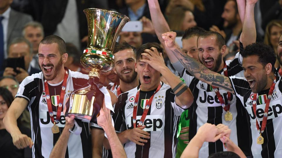 Juventus players celebrate with the trophy after winning the Coppa Italia final against Lazio.