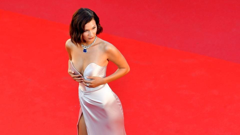 Bella Hadid poses as she arrives on May 17, 2017 for the screening of the film Ismael's Ghosts during the opening ceremony of the 70th edition of the Cannes Film Festival.