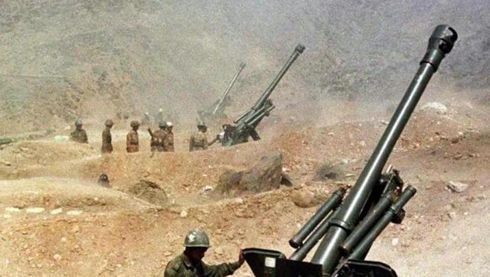 Soldiers from the Indian army fire their 105mm artillery guns on May 31, 1999, from their outpost near Kargil.