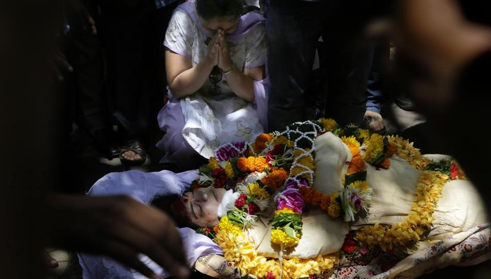 A woman wails near the body of Bollywood actor Reema Lagoo during her funeral in Mumbai.