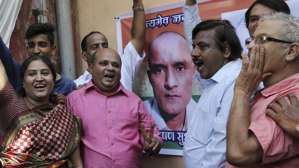 Friends of former Indian naval officer Kulbhushan Jadhav celebrate the International Court of Justice order on Thursday.