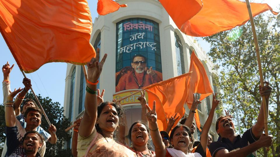 Members of the Shiv Sena party take part in a rally after victory in the BMC election in Mumbai in February.