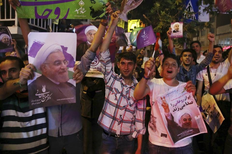 Supporters of Iranian President Hassan Rouhani during a street campaign in Tehran.