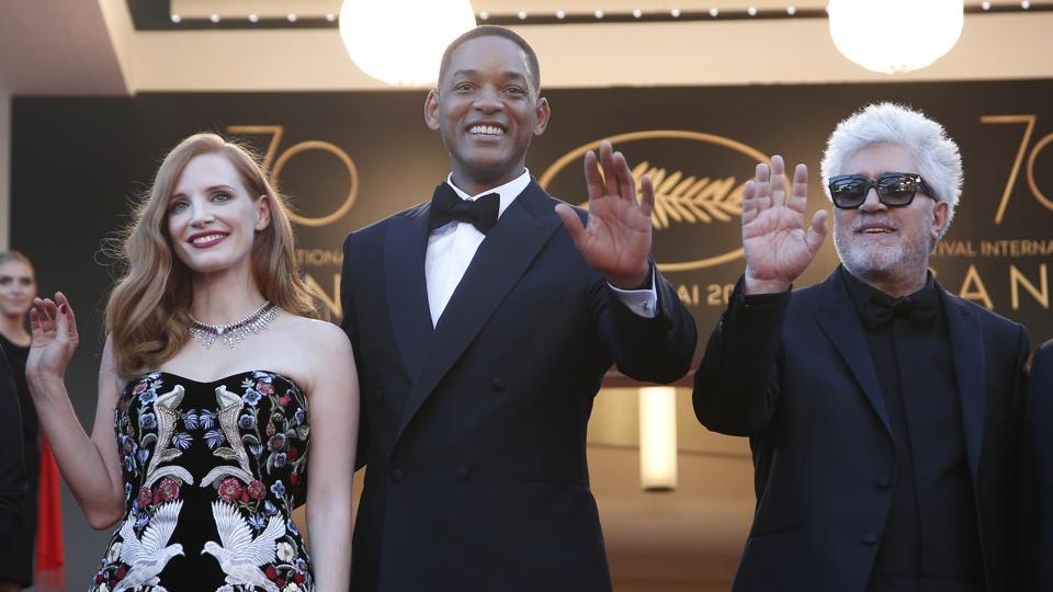 Jury members Jessica Chastain, from left, Will Smith and jury President Pedro Almodovar pose for photographers upon arrival at the opening ceremony at the 70th international film festival, Cannes, southern France, Wednesday, May 17, 2017.