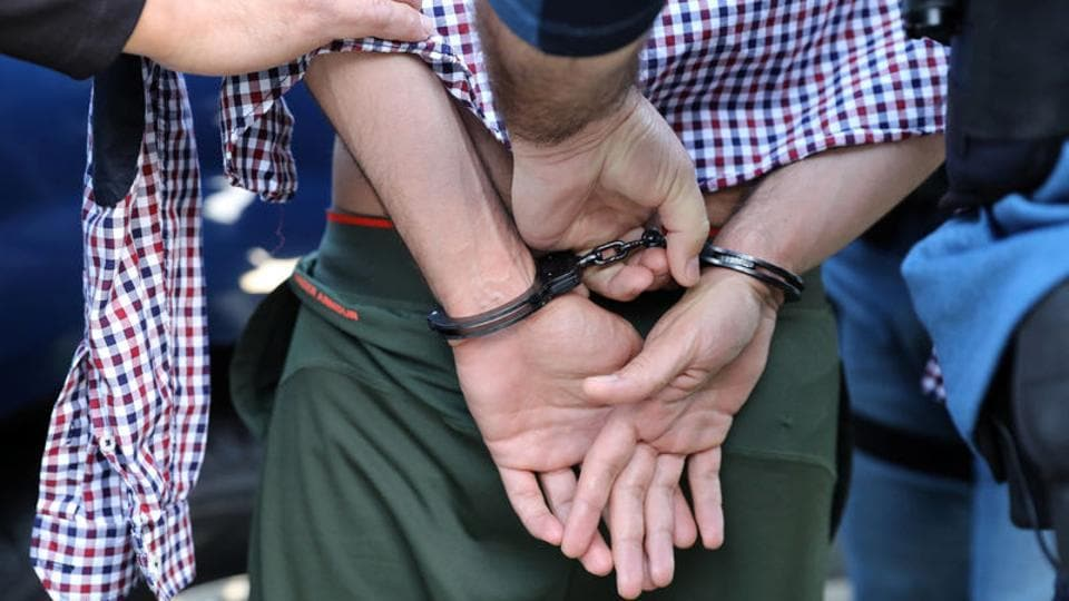 US Immigration and Customs Enforcement (ICE) officers arrest an Iranian immigrant in San Clemente, California on May 11.