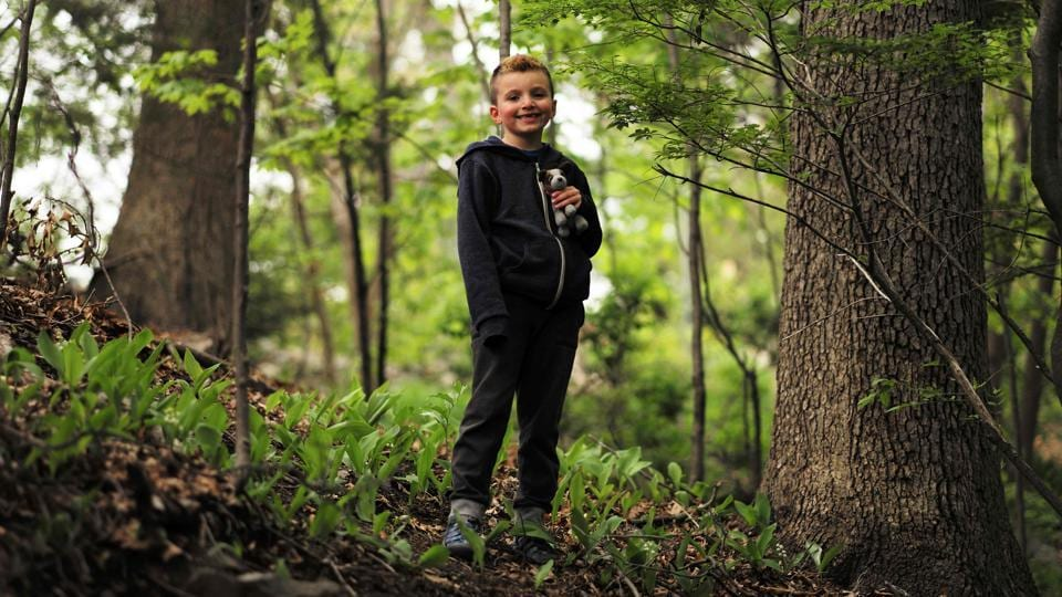 Seven-year-old transgender boy Jacob Lemay poses for photos in the yard of his home in Melrose, Massachusetts. (JEWEL SAMAD / AFP)
