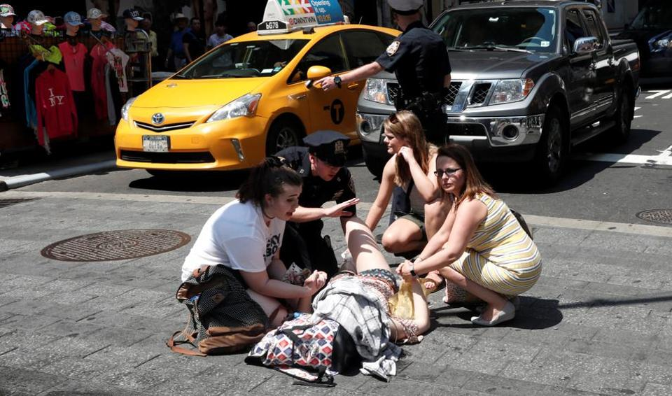 An injured woman is seen at a crosswalk in Times Square after a speeding vehicle struck pedestrians on the sidewalk in New York City.