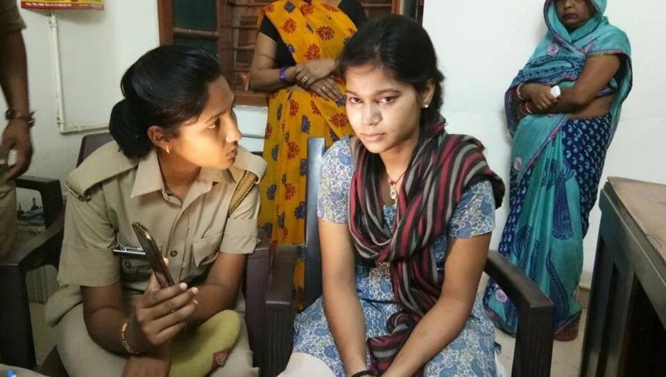 Varsha Sahi being interrogated by police.