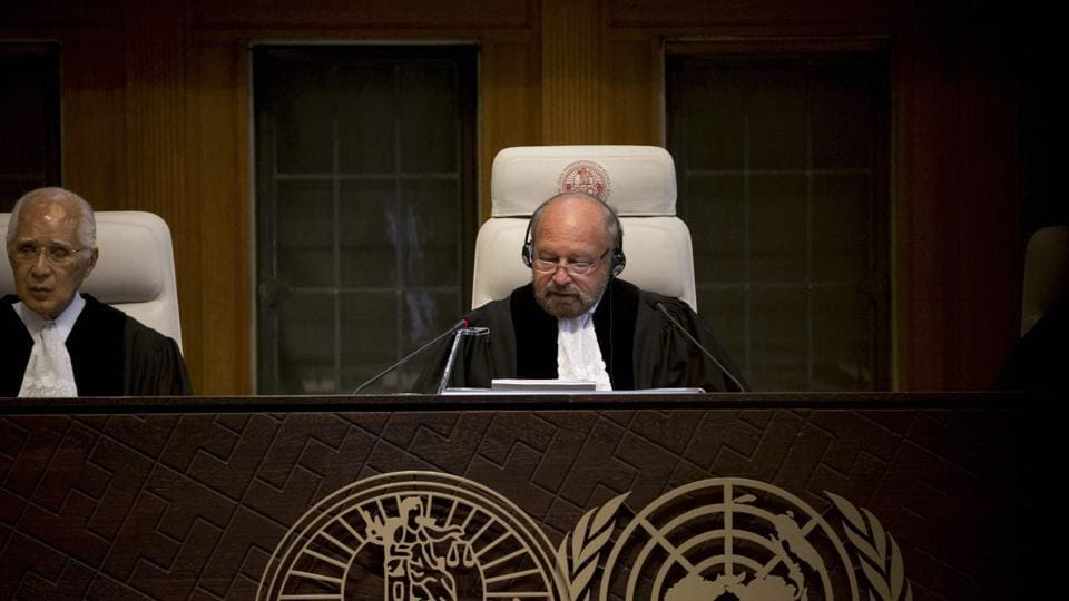 Presiding judge Ronny Abraham of France reads the World Court's verdict in the case brought by India against Pakistan in The Hague, Netherlands on May 18.