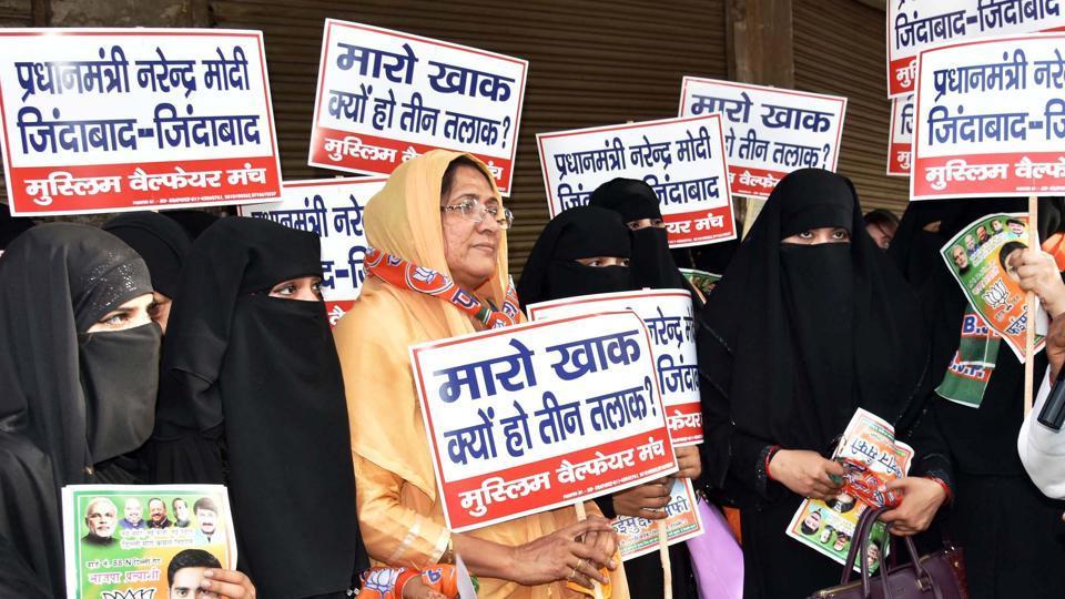 Muslim women hold placards against 'triple talaq' in New Delhi