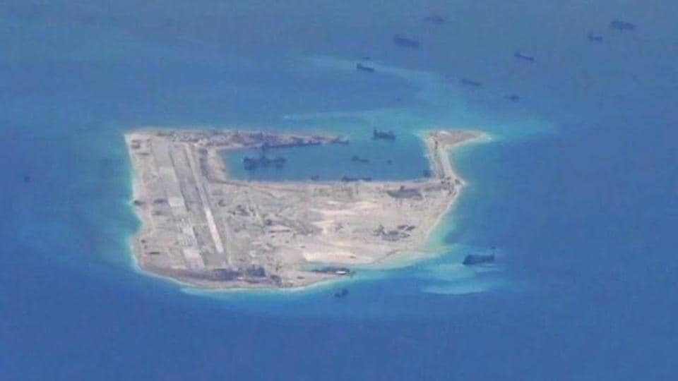 Chinese dredging vessels purportedly seen in the waters around Fiery Cross Reef in the disputed Spratly Islands in the South China Sea in this still image from video taken by a P-8A Poseidon surveillance aircraft provided by the US.