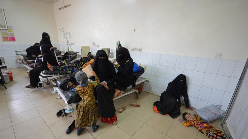 A girl infected with cholera lies on the ground of a hospital room in the Red Sea port city of Hodeidah, Yemen.