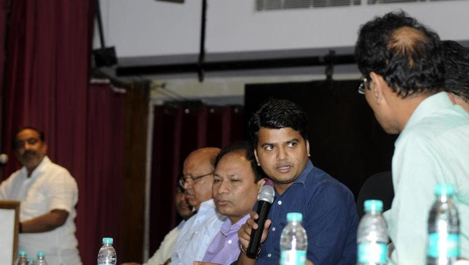 Manish Verma, additional chief executive officer, Noida authority, speaks at the meeting held in Indira Gandhi Kala Kendra in Sector 6.  Assotech MD Sanjeev Srivastava is seen in the extreme left.