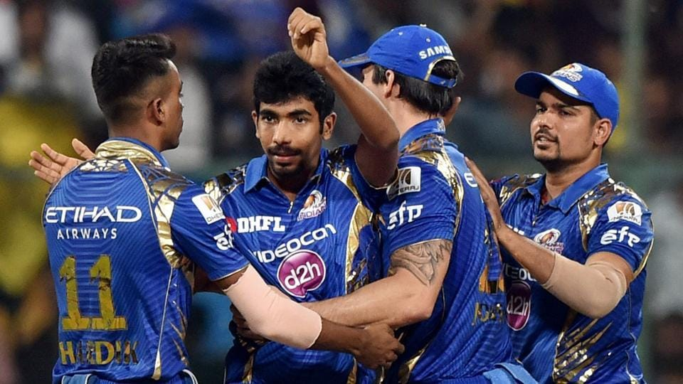 Mumbai Indians (MI) pacer Jasprit Bumrah (2nd left) and leggie Karn Sharma (right) took seven Kolkata Knight Riders (KKR) wickets between them to help push the Rohit Sharma-led side into the Indian Premier League final on Friday.