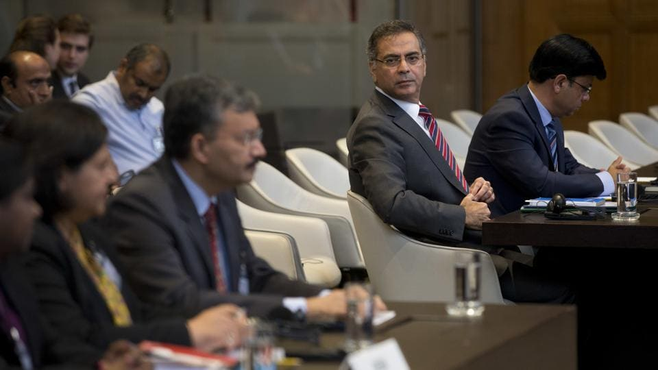 Moazzam Ahmad Khan, head of Pakistan's delegation and ambassador( second right), and Dr. Deepak Mittal, joint secretary of India's Ministry of External Affairs, (front row third from left), wait for judges to enter and read the World Court's verdict in The Hague, Netherlands, on May 18.