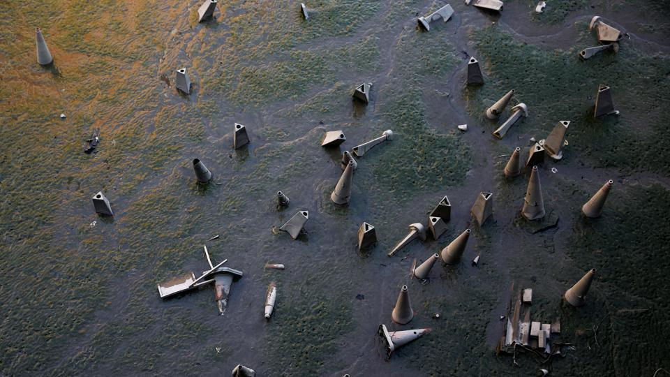 Discarded traffic cones part of waste lying on the banks of the River Thames during low tide. His photographs are both mundane and yet enigmatic.  (Stefan Wermuth/Reuters)