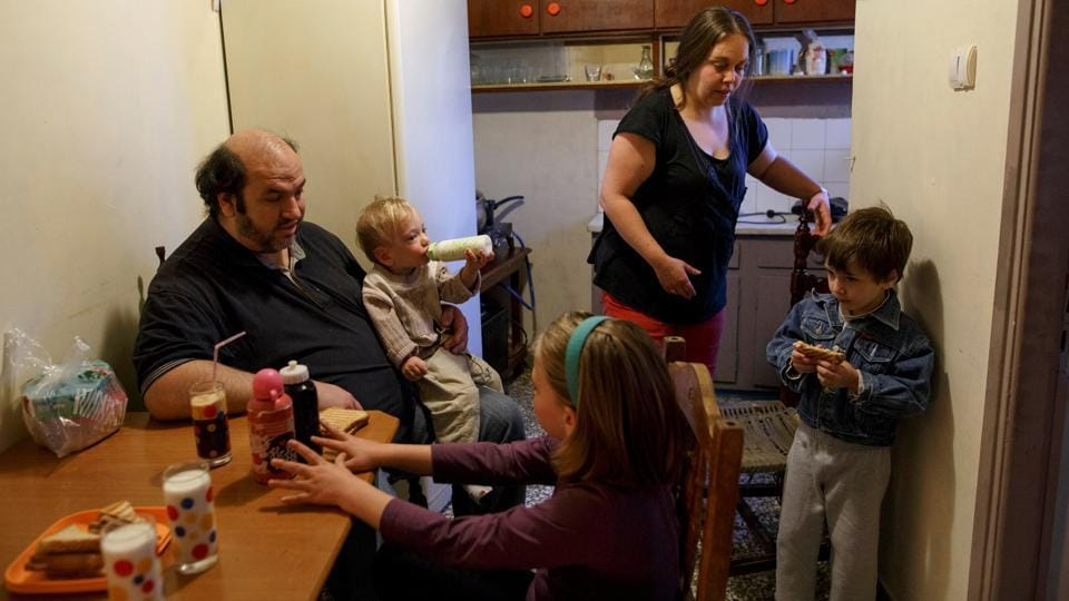 The Argyros family have breakfast at their house in the Keratsini neighbourhood in Athens.They live in a small apartment with four children.  (Alkis Konstantinidis/REUTERS )