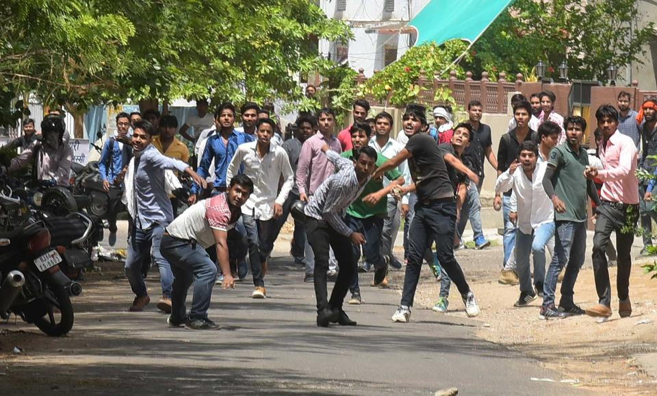 Students pelt stones at police officials after they blocked the JLN road during their protest at Rajasthan university in jaipur on friday. photo-