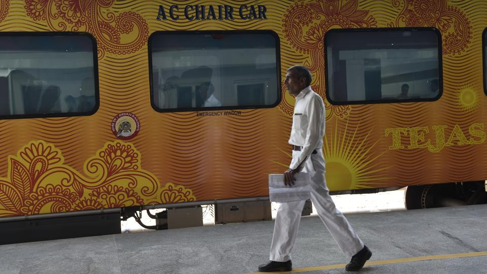 The stationary Tejas Express train with orange graphics and decals on the body at Delhi's Safdarjung station during  a press preview. (Arvind Yadav/HT PHOTO)