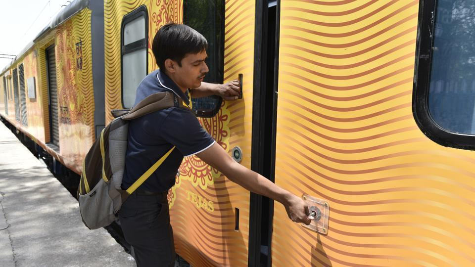 An operator keys in an automatic entrance plug door in the Tejas Express. (Arvind Yadav/HT PHOTO)