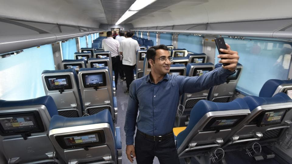 People take selfies during a press preview inside the train. (Arvind Yadav/HT PHOTO)