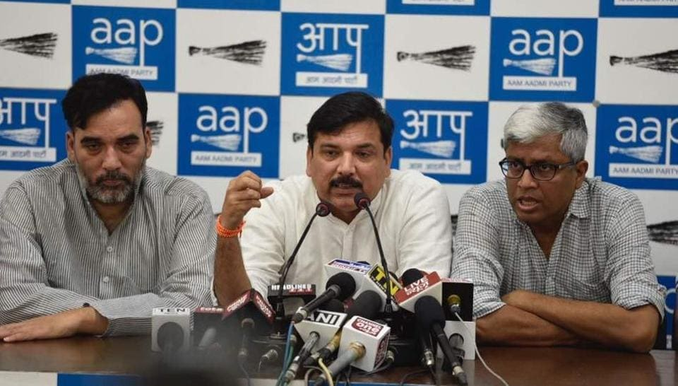 "At a press conference on Saturday, AAP leaders Sanjay Singh, Ashutosh and Gopal Rai accused the ECI of not announcing the date for a ""hackathon""."